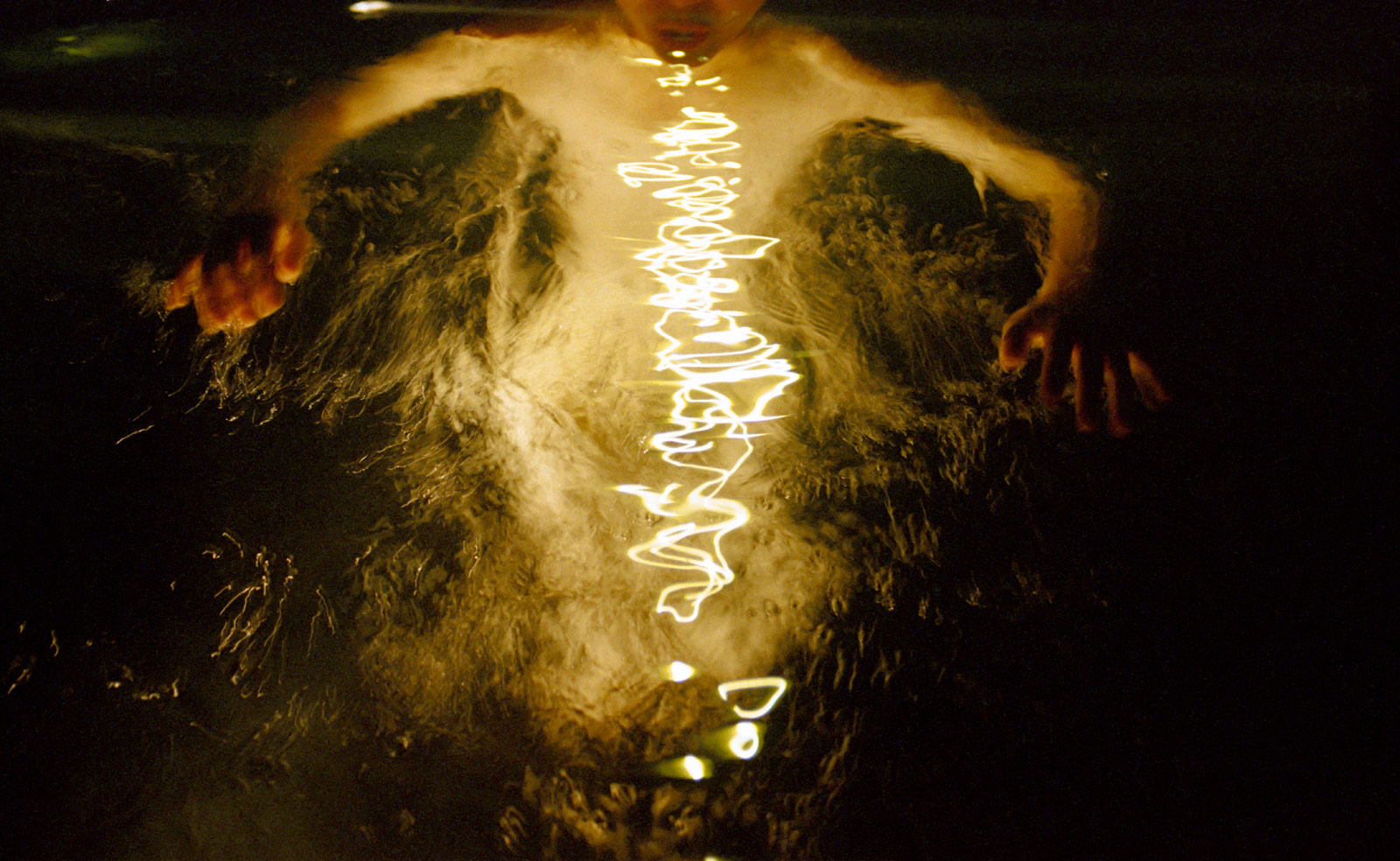 double exposure of a girl skinny dipping at night