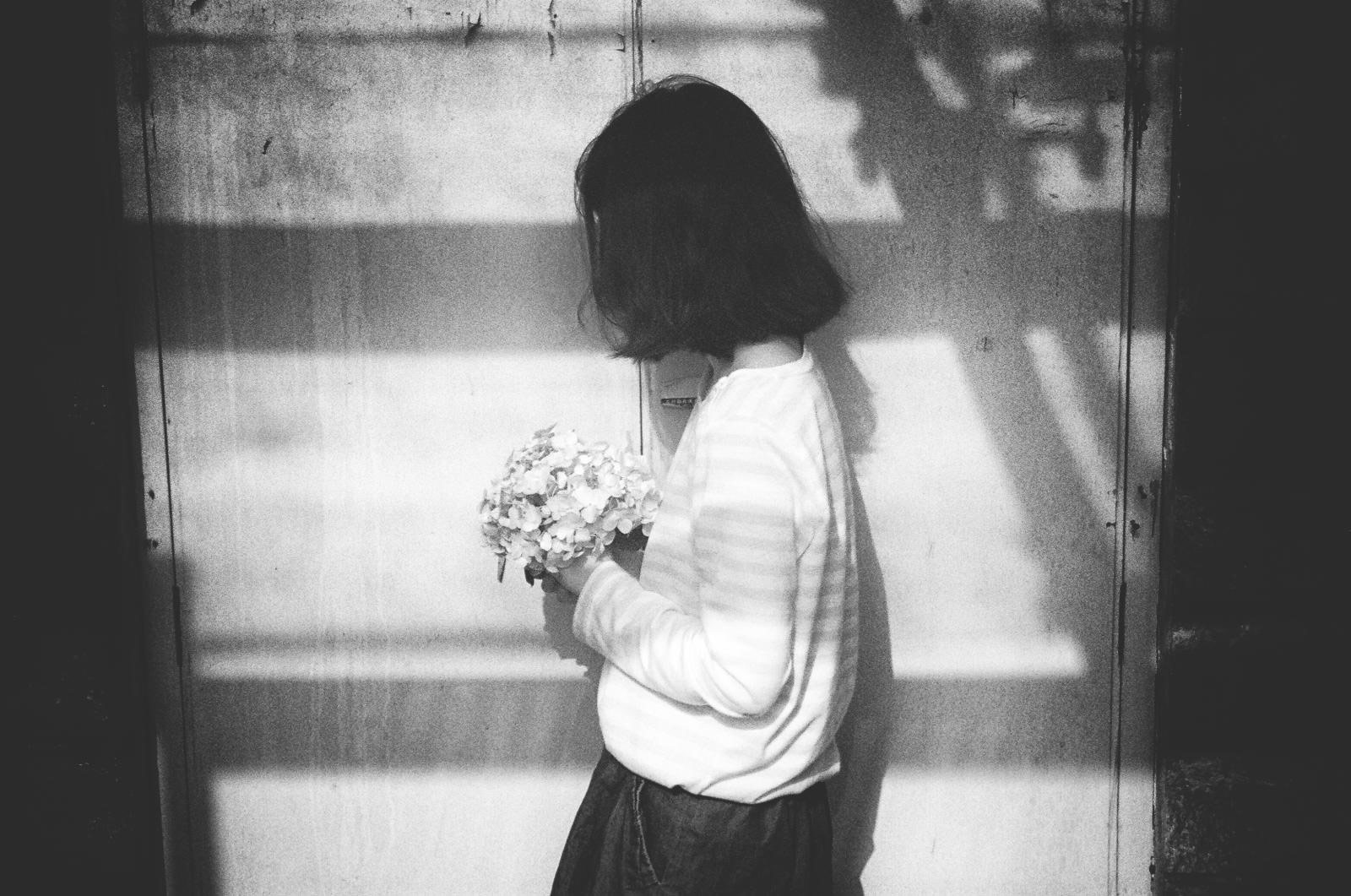 asian girl with a bouquet of flowers by Li Hui