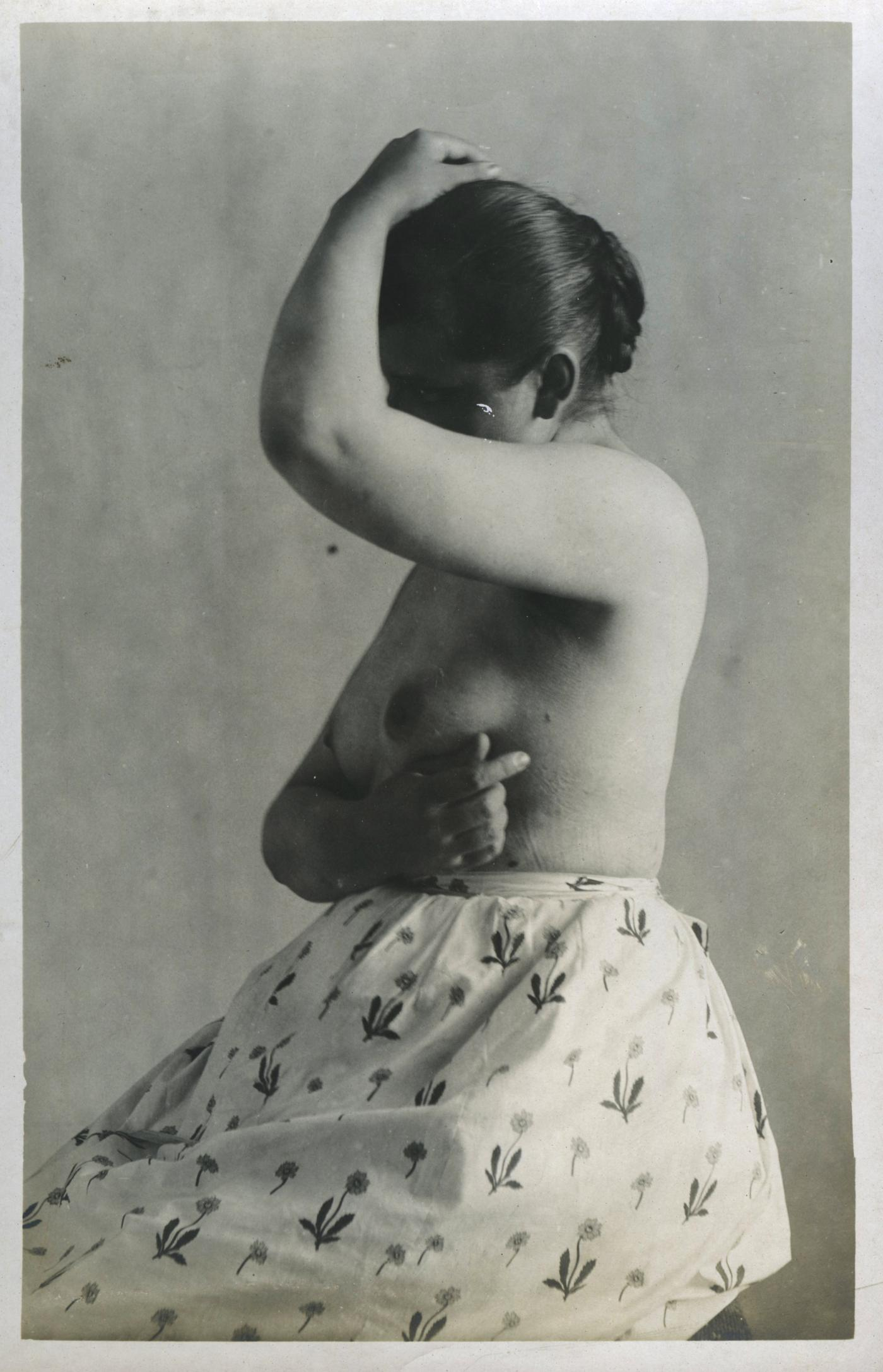 antique photograph of a topless woman in the 1890s