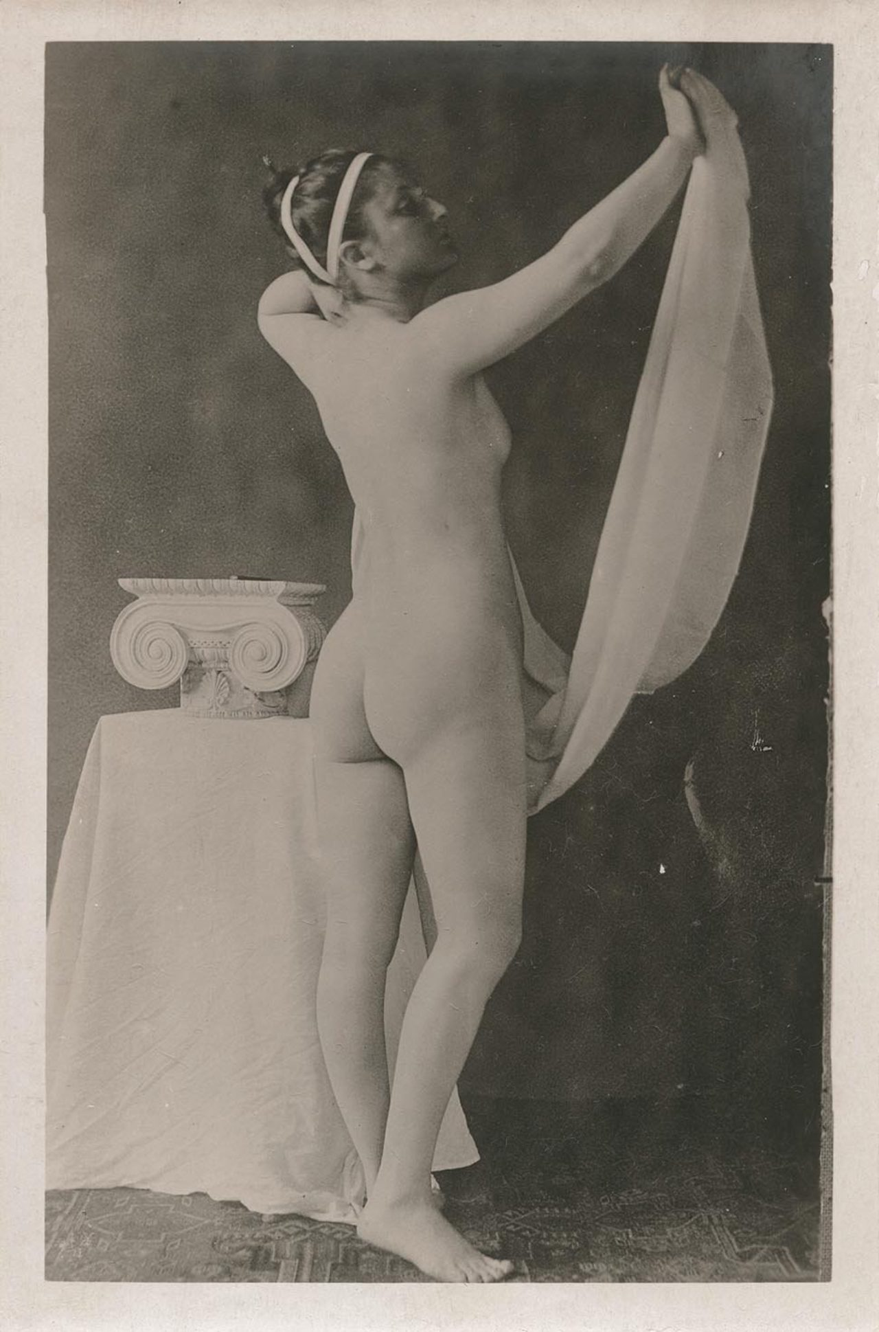 antique photo of a woman at a brothel