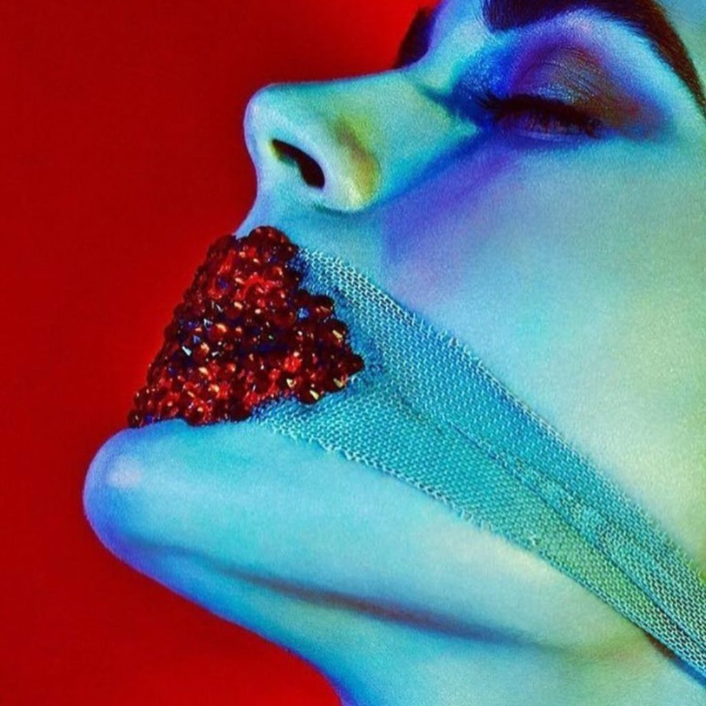 Pat McGrath jeweled red lips inspired by writer Charles Baudelaire