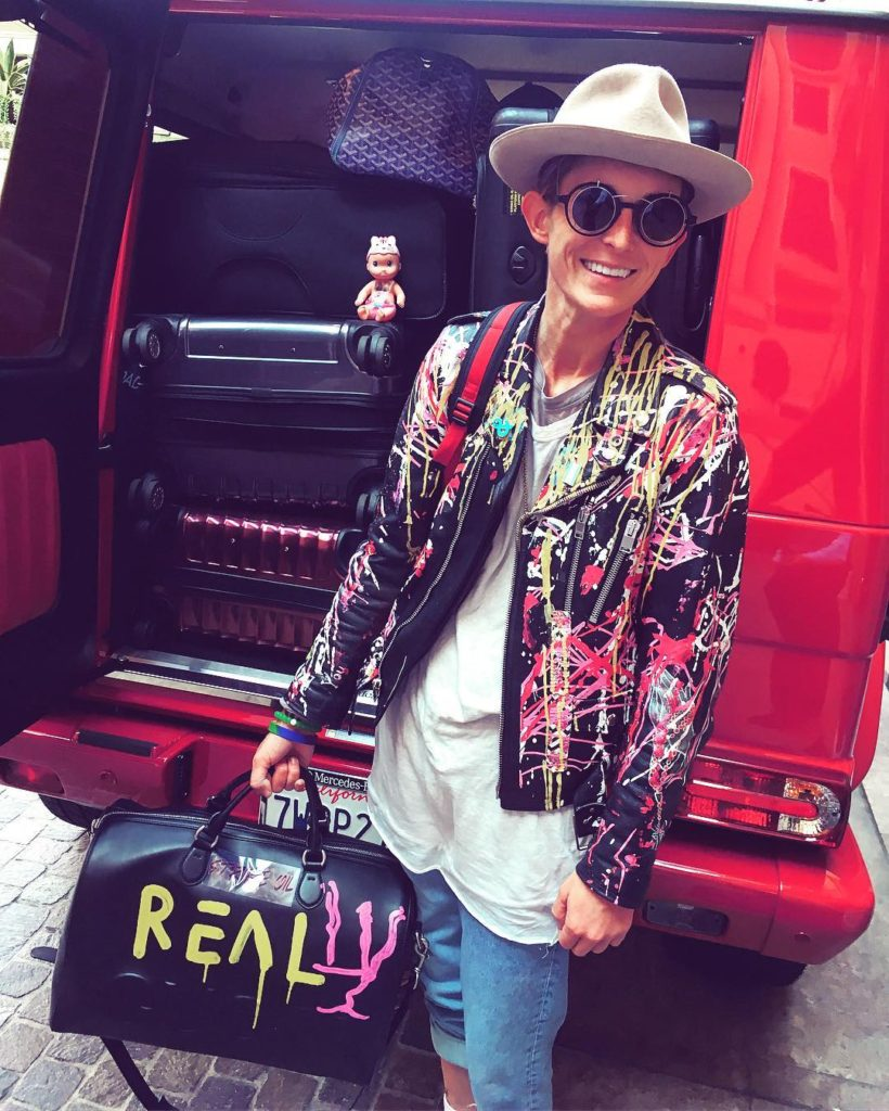 Nats Getty Wearing a Fedora, Her Own Spray Painted Jacket and Carrying a Bag Spray Painted with the word REALLY