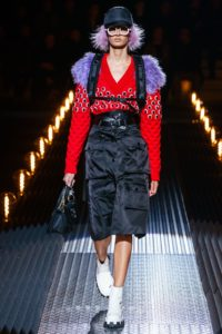 PRADA Men's 2019 Frankenstein Collection Runway Show in Milan Featuring Female Model with Lilac Hair, Lilac fur, White Sunglasses and White Patent Leather Boots