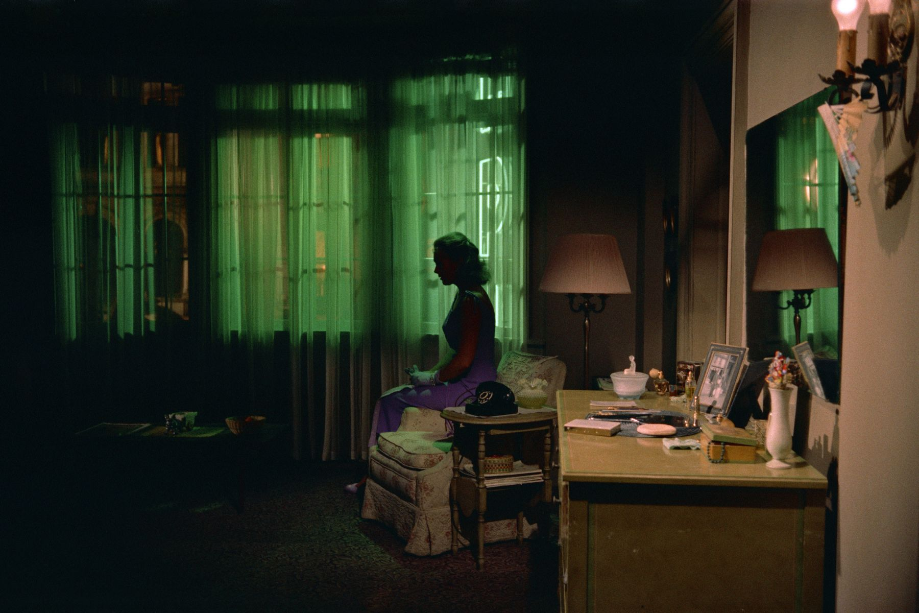 silhouette of a woman alone in an eerie room