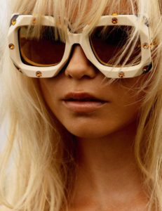 sexiest-fashion-photographers-inez and vinoodh-photo of a blonde model wearing white sunglasses adorned with topaz jewels