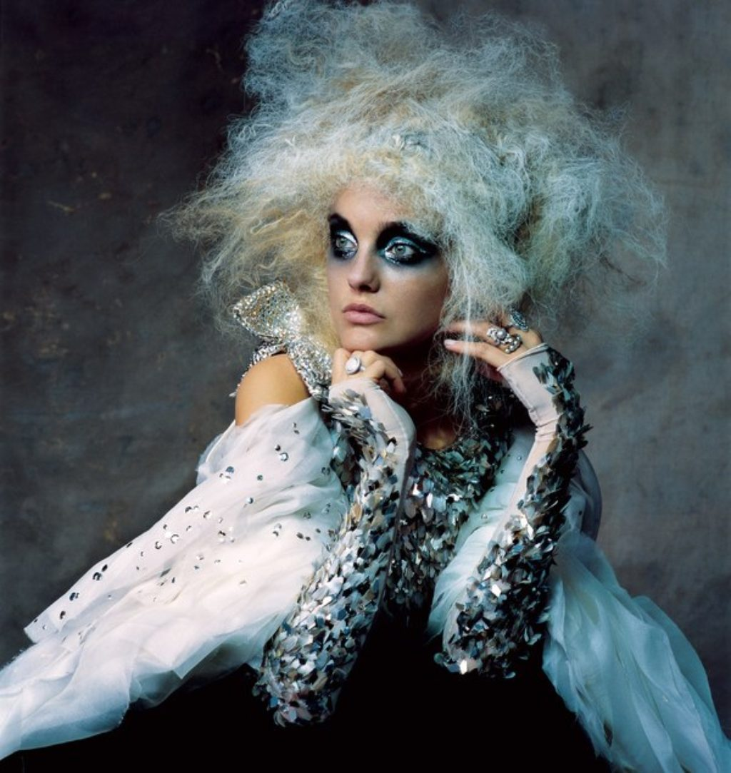 Karl Lagerfeld Couture-Model Wearing Wild Blue and White Big Hair Do and Heavy Black and Blue Eye Make Up