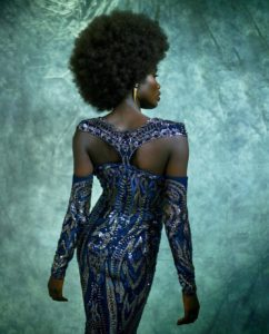 Marc Bouwer Navy and Silver Beaded Gown Worn by an African American Model with an Afro-Back View