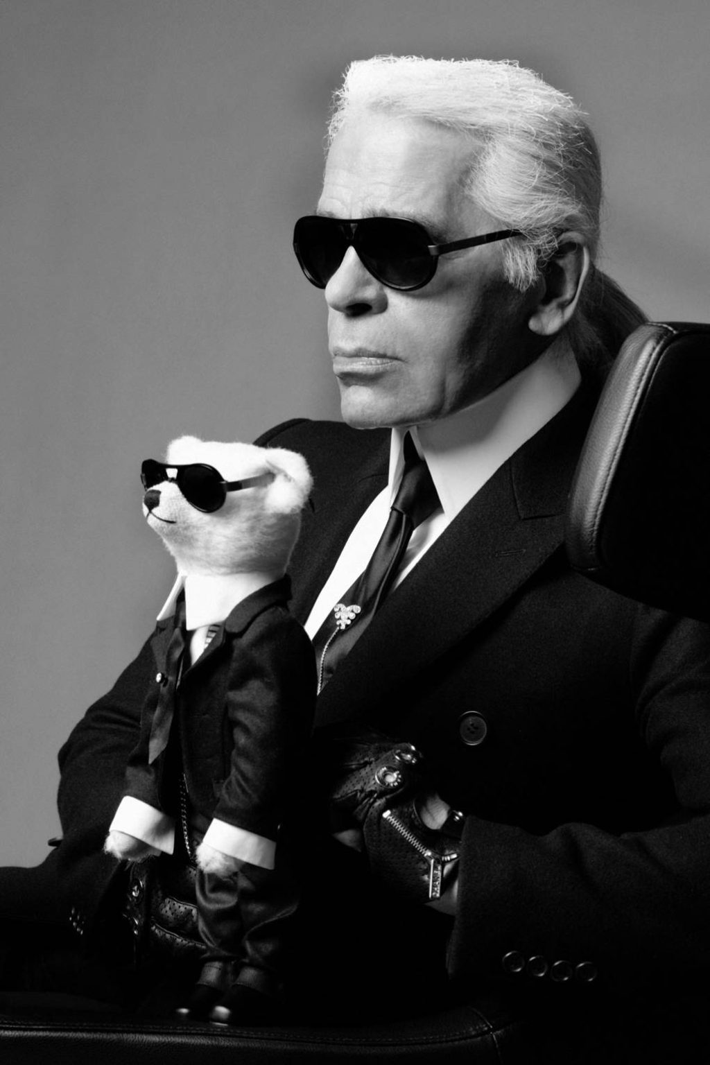 Photograph of Karl Lagerfeld Holding a Teddy Bear Wearing Matching Clothes and Sunglasses