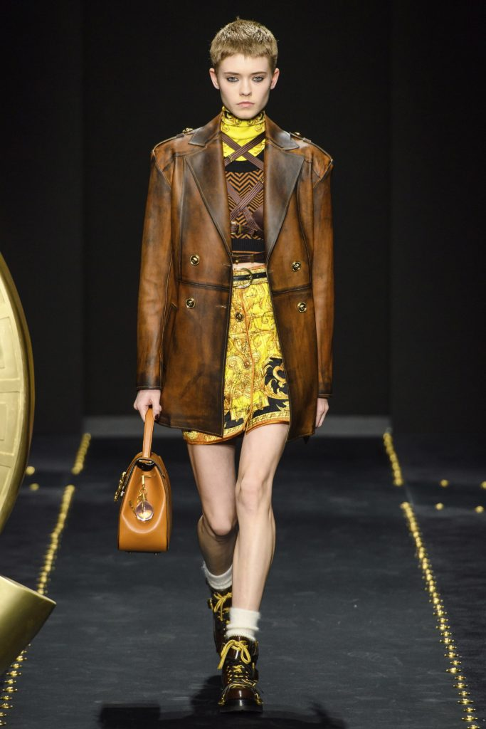 Versace Fall 2019 Runway Show-Model with short bob wearing a leather coat jacket