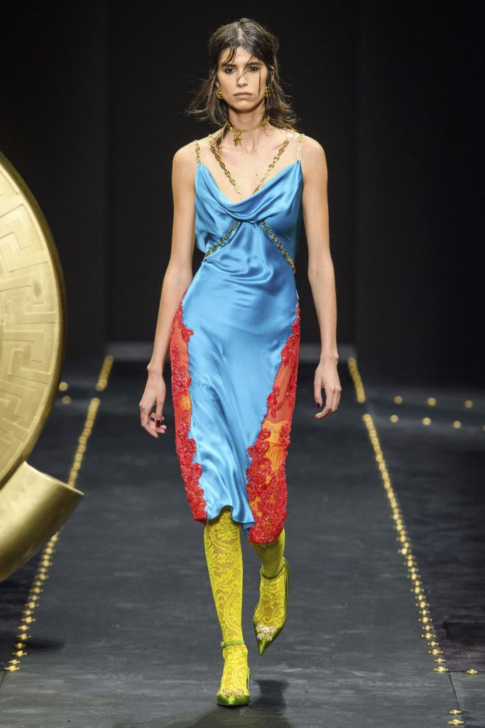 Versace collection fall 2019 runway show-model wearing blue negliget with red lace trim and yellow stockings