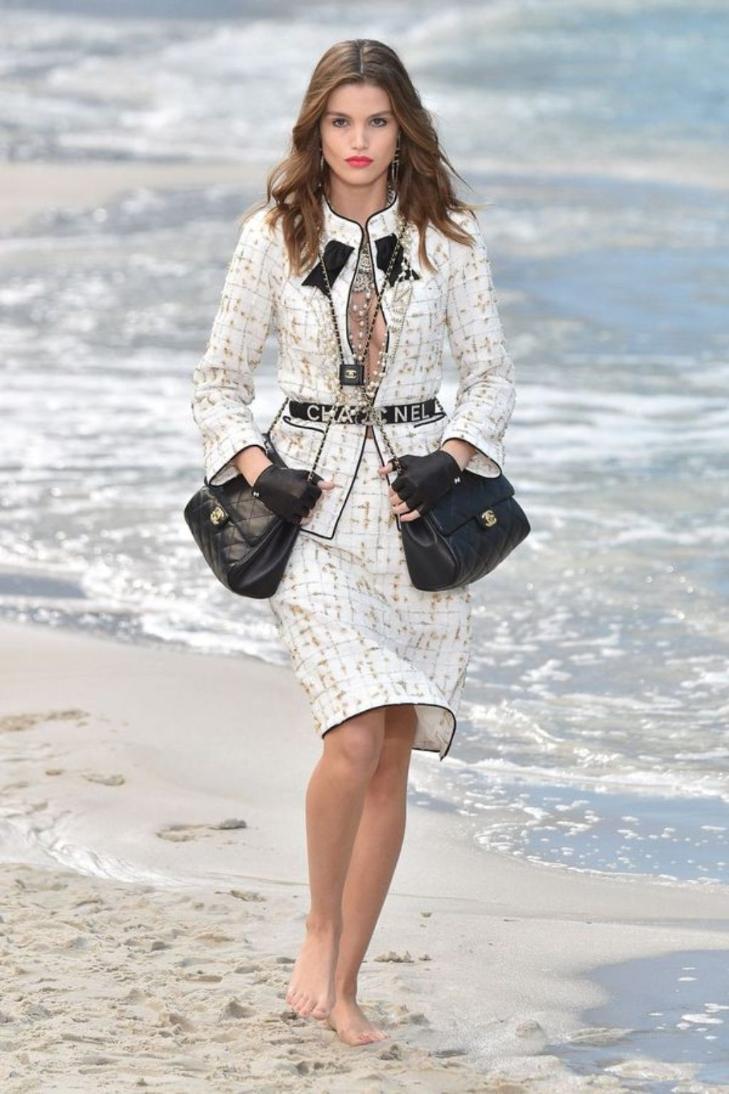 model-walks-the-runway-during-the-chanel-show-on the beach